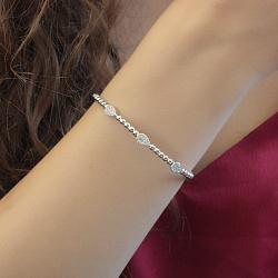 Жесткий серебряный браслет Капли света с белыми фианитами