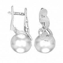 Серебряные серьги Селеста с изображением дельфина и волны на литом шаре