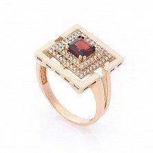 Золотой перстень Примадонна с фантазийной шинкой, гранатом и фианитами