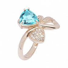 Кольцо в красном золоте Сюрприз с голубым топазом и фианитами