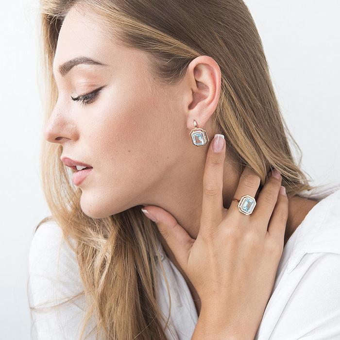 Золотой перстень Бронкс с голубым топазом и фианитами 000082298