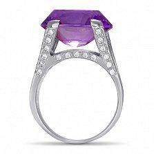 Серебряное кольцо Ева с дорожками фианитов на шинке и синтезированным аметистом