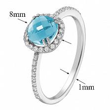 Золотое кольцо Антик в белом цвете с голубым топазом и фианитами