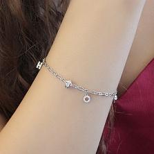 Серебряный браслет Тайное значение с подвесками в виде буквы Н, круга в фианитах и рыбки