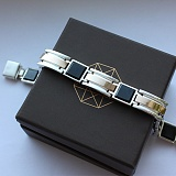 Серебряный браслет с золотыми вставками и ониксом Подкова