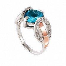 Серебряное кольцо Стелла с золотой вставкой и голубым цирконием