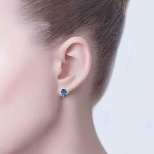 Серьги-гвоздики из серебра с синим цирконом Капелька