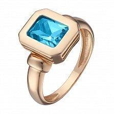 Кольцо в красном золоте Шарлотта с голубым топазом
