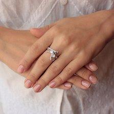 Серебряное кольцо Замкнутая молния с фианитами