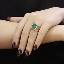 Золотое кольцо Дональто в желтом цвете с широкой шинкой, изумрудом и бриллиантами