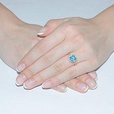 Кольцо в красном золоте Келли с голубым топазом и фианитами