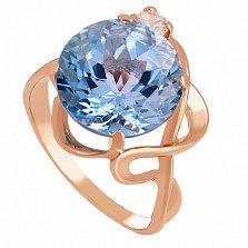 Золотое кольцо с топазом и фианитом Джунгли