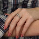 Золотое кольцо с бриллиантами и сердцем в касте