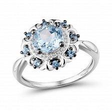 Золотое кольцо Зури в белом цвете с цветком, бриллиантами и топазами