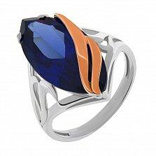 Серебряное кольцо Алана с золотыми накладками и синтезированным камнем