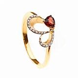Золотое кольцо с гранатом и бриллиантами Регина