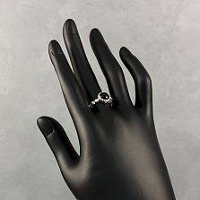 Серебряное кольцо Мистерия с черным ониксом и золотыми накладками