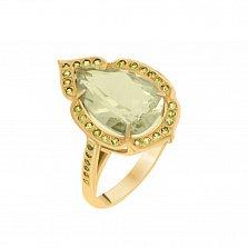 Золотое кольцо Аурелия в желтом цвете с зеленым кварцем и зелеными гранатами