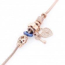Золотой браслет с шармами и подвесками Тайна сердца с синей эмалью и фианитами