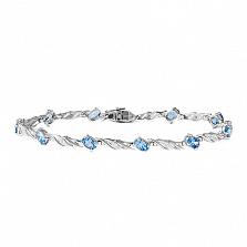 Золотой браслет Блюз в белом цвете с голубыми топазами и бриллиантами на 10 звеньев