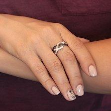 Серебряное родированное кольцо Спираль с черными и белыми фианитами