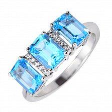 Кольцо из белого золота с голубыми топазами, фианитами и родированием 000131340