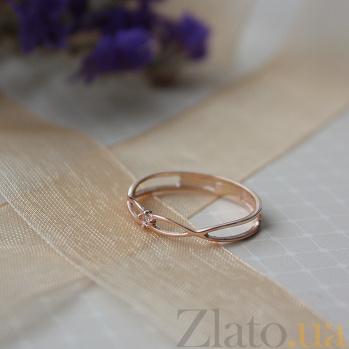 Золотое кольцо Бесконечное переплетение в красном цвете с бриллиантом 000071081