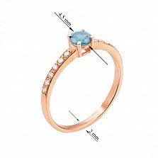 Золотое кольцо Долли в красном цвете с голубым топазом и фианитами