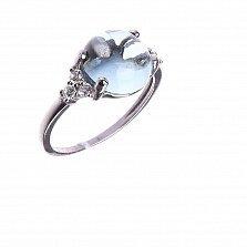 Серебряное кольцо Круглая капля с голубым топазом и белыми фианитами