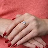 Золотое кольцо Ксения с голубым топазом и фианитами