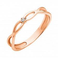 Золотое кольцо Бесконечное переплетение в красном цвете с бриллиантом