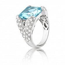 Золотое кольцо Айсберг в белом цвете с голубым топазом и бриллиантами