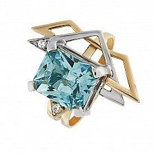 Кольцо в красном золоте Кассиопея с голубым топазом и фианитами