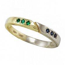 Кольцо Двойная удача в красном и белом золоте с синтезированными изумрудами и сапфирами