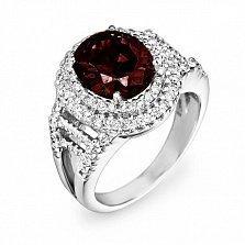 Золотой перстень Монсария в белом цвете с узорной шинкой, гранатом и бриллиантами