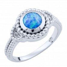 Серебряное кольцо Плетенка с голубым опалом