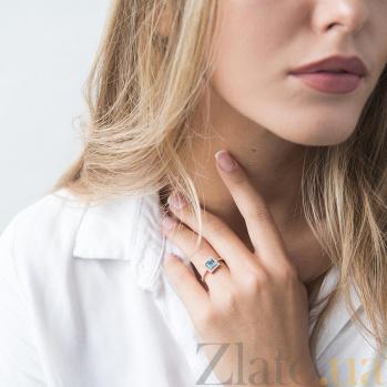 Золотой перстень Триумф с голубым топазом и дорожкой белых фианитов на шинке 000082331