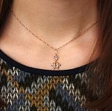 Золотой кулон Парочка Амуров с алмазной насечкой