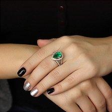Золотое кольцо Мельпомена с изумрудом и бриллиантами