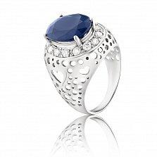 Золотое кольцо Борджиа в белом цвете с перфорацией на шинке в виде сердец, сапфиром и бриллиантами