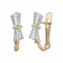 Золотые серьги Сверкающий бант с бриллиантами