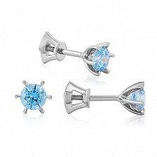 Серьги-пуссеты из белого золота Лучи света с голубыми кристаллами Swarovski