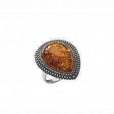 Серебряное кольцо Рошель с чернением и оранжевым янтарем