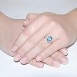 Золотое кольцо Виктория с голубым топазом и фианитами