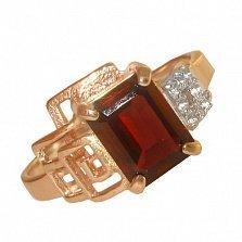 Золотое кольцо с гранатом и фианитами Клаудия