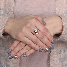 Золотое кольцо Сюзанна с голубым топазом и фианитами