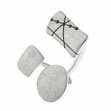 Серебряное кольцо с фианитами Интрига