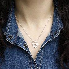 Серебряное колье Сердце в сердце с родированием, белыми эмалью и фианитами