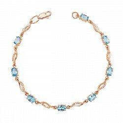 Золотой браслет Женская фантазия в красном цвете с голубыми топазами и фианитами
