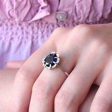 Серебряное кольцо Динара с золотыми накладками, синим и белыми фианитами